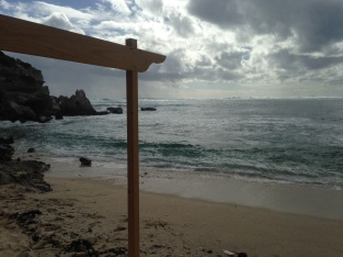 The day of Jo and Matt's barefoot beach wedding - the tide was high!