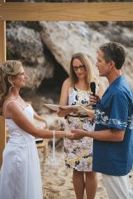 Jo and Matt exchanging vows - photo by Driftwood Photography