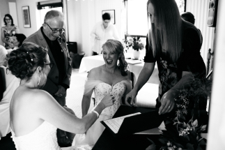 Time to Sign! - photo by Kelly Harwood Photography