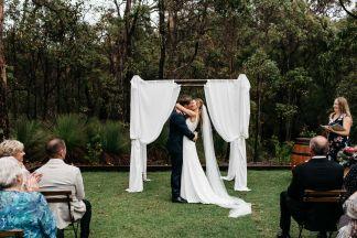 Jess and Lachie First Kiss Bina Maya Yallingup Escape photo by Kelly Harwood Photography